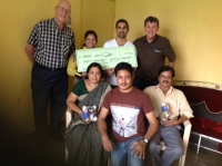Alan Mower & Garry South present a cheque to Mahesh Kumar