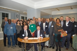 Chair of ICSW, Hennie la Grange, & Chair of ISAN, Mark Chahne-Warrington, sign merger document with members of the ICSW