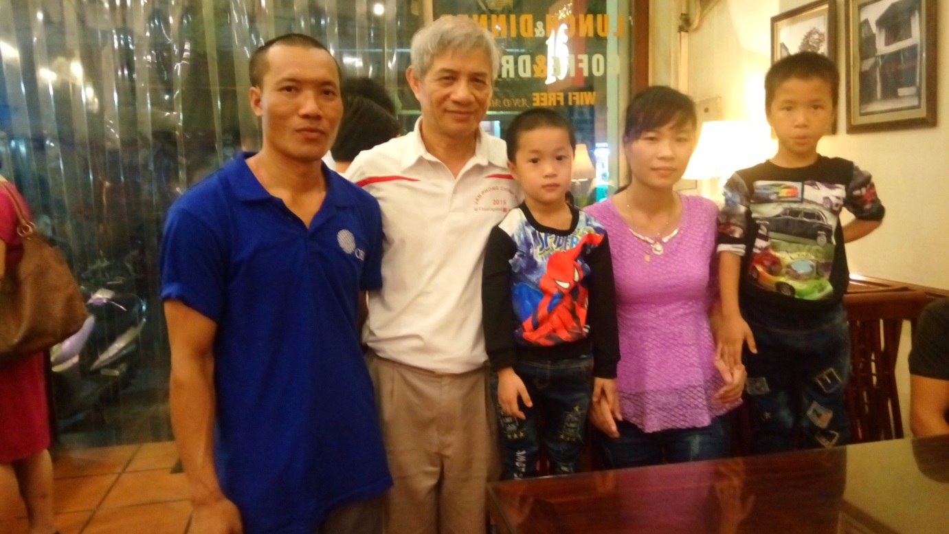 One of the Vietnamese seafarers (on left) with his family and Capt Nguyen Viet Anh